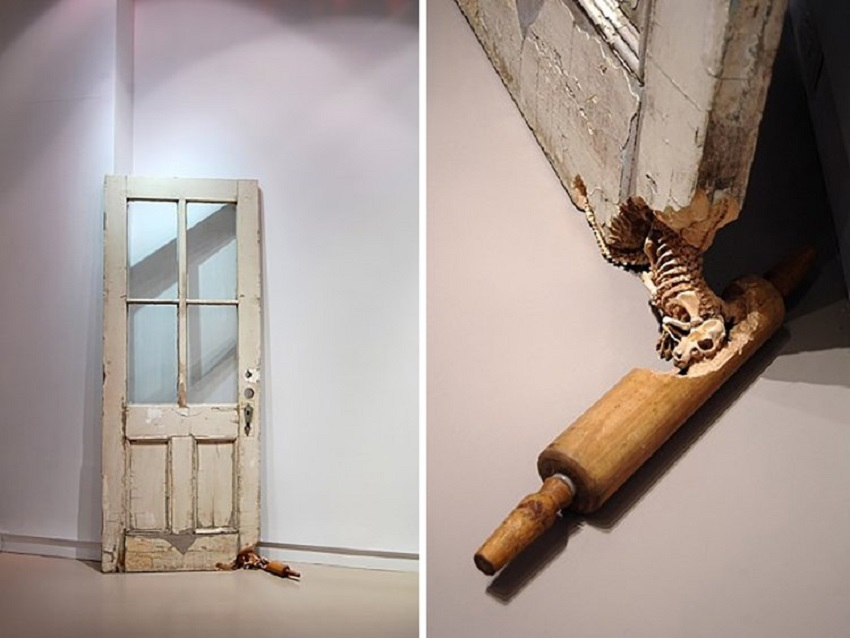 Rat skeleton carved into a door and rolling-pin. 001