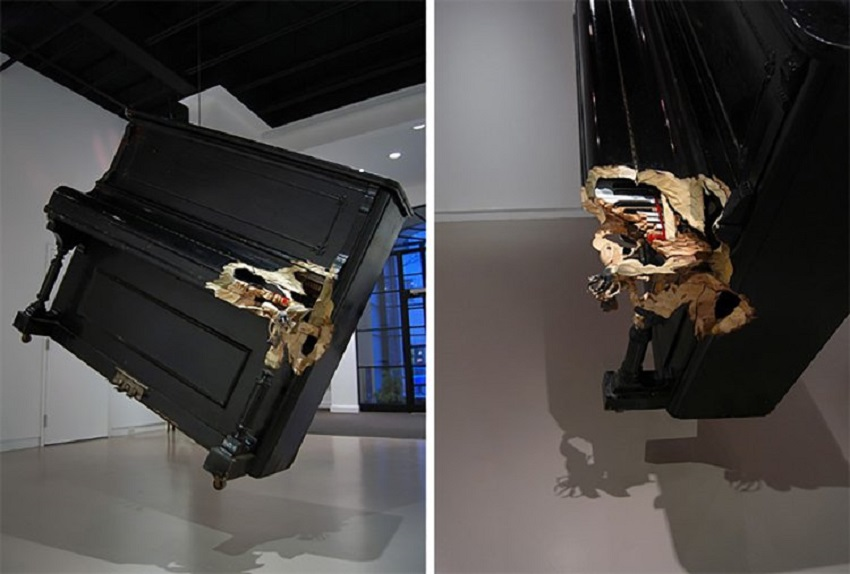 Rhinoceros beetle carved into a piano (hanging level from the ceiling). 001