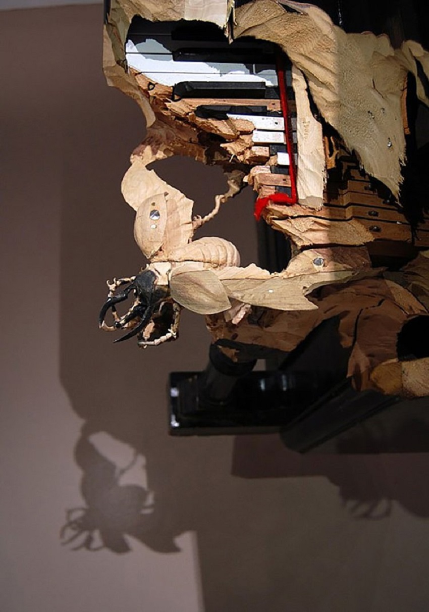 Rhinoceros beetle carved into a piano (hanging level from the ceiling). 002